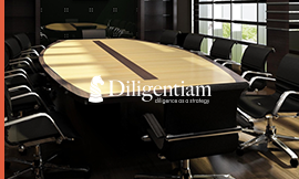 Large conference table with chairs representing due diligence strategy providing critical data for the decision makers in your company